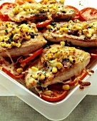 Turkey escalope with corn coating and tomatoes