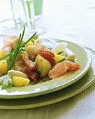 Potato and asparagus salad with raw ham and chives