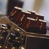 Brown espresso cups on an espresso machine