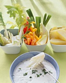 Cream cheese and herb fondue with vegetables and pears