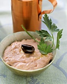 Fish roe mousse with olive and parsley