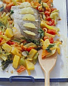 Oven-baked fish with lemons and mixed vegetables