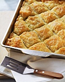 Puff pastry pie with spinach & sheep's cheese in baking dish