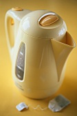 Yellow water boiler with tea bag