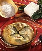 Spinach and sheep's cheese strudel in a glass dish