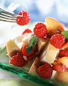 Fruit salad with apples, raspberries and cinnamon