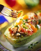 Stuffed courgettes with rice, tomatoes and peppers
