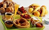Breakfast with coffee, croissant, fruit, egg, orange juice