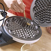 Greasing a waffle iron