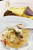 Seafood ravioli with pine nuts