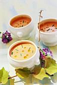 Tomato soup in white soup bowls