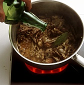 Basting meat with wine