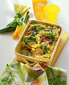 Penne bake with courgettes, tomatoes and basil