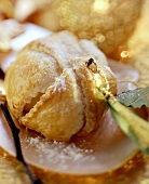 Vanilla apples in puff pastry with icing sugar