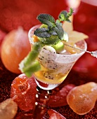 Champagne sangria with fruit and mint; candied fruit