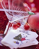 Cocktail glass and napkin with inscription Santa Baby