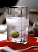 Raki with olive in glass