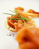 Salmon roll with chives and pink pepper