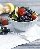 Berry salad with sugar and vanilla pod