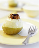 Baked apple with raisins and cream