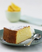 Piece of orange cake with icing sugar