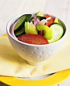 Raw vegetable salad in white bowls
