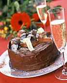 Festive chocolate gateau, champagne and bouquet