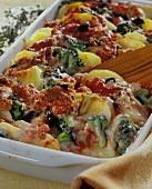 Potato gratin nicoise with tomatoes, broccoli & olives