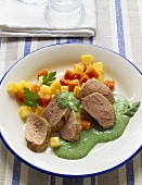 Pork fillet with parsley sauce and diced vegetables