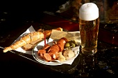 Sausage with beer at a sausage stall in Vienna