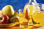 Apple and pear juice; apples and pears in basket