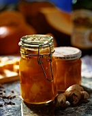 Sweet and sour ginger pumpkin in preserving jars