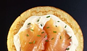 Blini with salmon, sour cream and chives