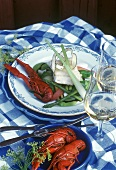 Swedish fish platter with vegetables; white wine