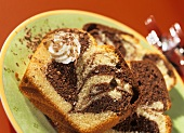 Slices of marble cake with blobs of cream