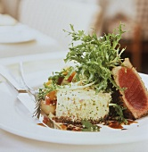 Pink fried tuna with couscous and salad