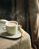 Steaming cocoa in white cup