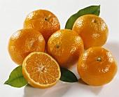 Several mandarins, one halved
