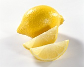 Lemon and two wedges of lemon