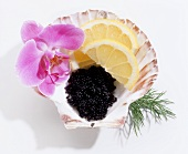 Caviare with lemon wedges in shell