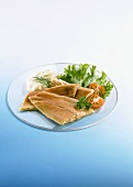 Trout fillets with mayonnaise and salad garnish