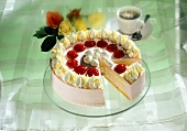 Festive raspberry gateau with cream; coffee; roses