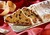 Christmas stollen, pieces cut, on cake plate