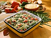 Autumn vegetable gratin in baking dish