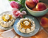 Meringue tart with apricots; roses; fresh apricots