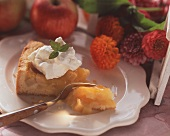 Piece of Alsatian cider tart with cream