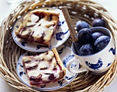 Plum cake with quark and fresh plums on tray