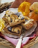 Yeast cake with poppyseeds, quark, apples & icing sugar