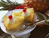 Two pieces of pineapple cake with cream & cocktail cherries