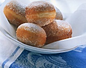 Fresh doughnuts with sugar on white plate